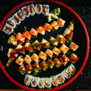 Lacquer tray of assorted sushi rolls