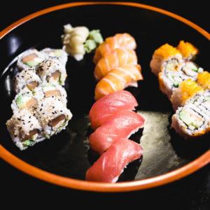 Philly roll, tuna & salmon nigiri, and California roll