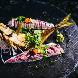 Whole aji (Japanese horse mackerel) sashimi
